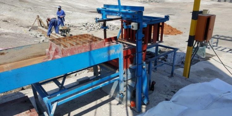 Brickmaking machine used with