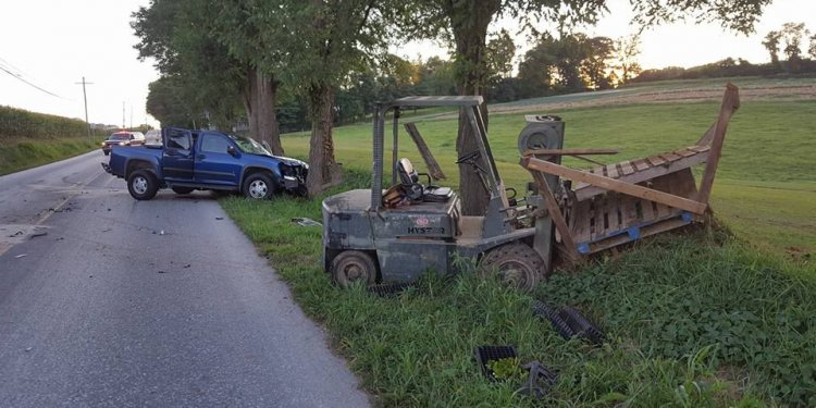 Pickup truck strikes forklift