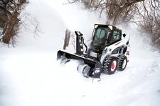Bobcat S590 M2-Series skid-steer loader with snowblower attachment.