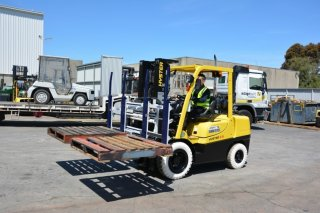 forklift with multi load attachment action
