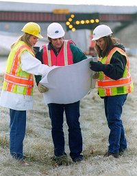 MDOT construction workers going over plans.