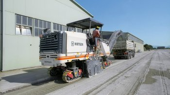 Milling off a concrete surface on company premises.