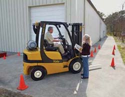 Operator being trained on working on a loading dock.