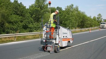 Removing road markings.