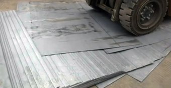 The forklift was trying to pick up a stack of 52 iron sheets when it began to tip over